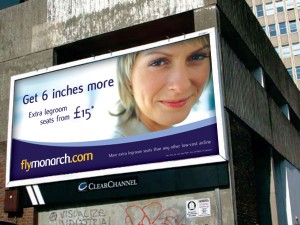 Picture of outdoor poster with headline 'Get 6 inches more' (legroom) next to a woman