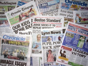 Picture of a spread of local papers